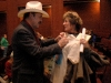 Rob Quist signs a t-shirt for a fan
