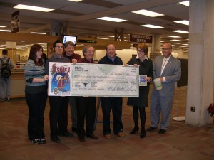 ULAC representatives present the check to library dean, Bonnie Allen.