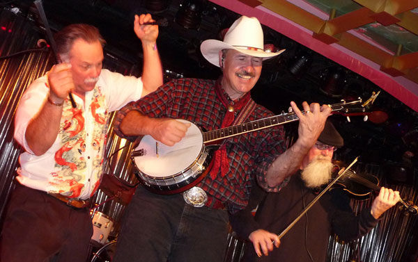 Steve Riddle, left, and Rob Quist of the Mission Mountain Wood Band get down on a Caribbean cruise ship in 2010.